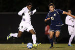 24 November 2013: Wake Forest's Sean Okoli (9) and Navy's Martin Sanchez (21). The Wake Forest University Demon Deacons played the Naval Academy Midshipmen at Spry Stadium in Winston-Salem, NC in a 2013 NCAA Division I Men's Soccer Tournament Second Round match. Wake Forest won the game 2-1.