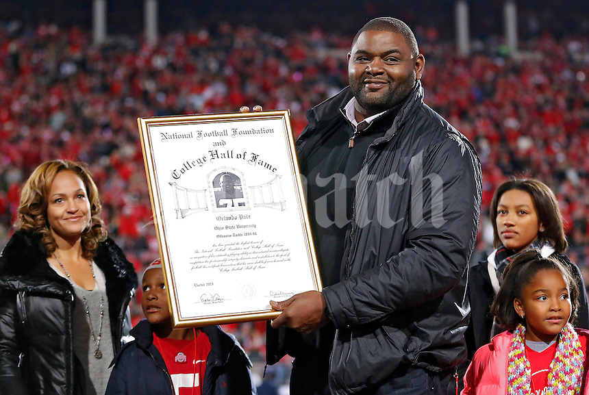 Former Ohio State Buckeye Orlando Pace received his College Football Hall of Fame plaque between the 1st and  2nd quarter at Ohio Stadium on October 26, 2013.  (Dispatch photo by Kyle Robertson)