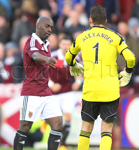 30.11.2014.  Edinburgh, Scotland. Scottish Cup.  Hearts versus Celtic. Margaro Gomis gives the captains armband to Neil Alexander after his red card