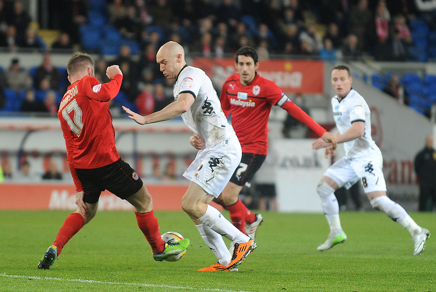 Cardiff City's Aron Gunnarsson cuts out Derby's Conor Sammon..Football - npower Football League Championship - Cardiff City v Derby County - Tuesday 05th March 2013 - Cardiff City Stadium - Cardiff..© CameraSport - 43 Linden Ave. Countesthorpe. Leicester. England. LE8 5PG - Tel: +44 (0) 116 277 4147 - admin@camerasport.com - www.camerasport.com