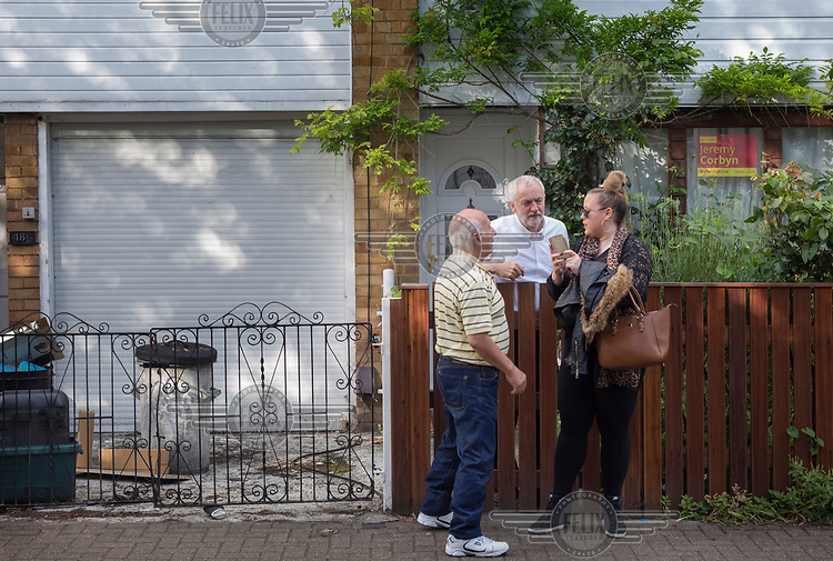 Leader of the Labour Party Jeremy Corbyn is congratulated by constituents while on a stroll to his office from his home in Holloway, north London, on the afternoon after the 2017 general election which resulted in a hung parliament and better than predicted results for Labour.