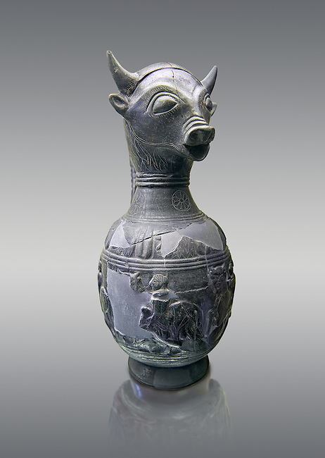 6th century BC Etruscan Bull headed bucherro style oinochoe, or wine jug,  made in Chuisi and excavated from the necropolis de Fonte Rotella, inv 3190, National Archaeological Museum Florence, Italy , against grey