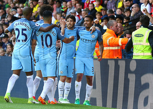 May 21st 2017, Vicarage Road, Watford, Herts, England; EPL Premier league football, Watford versus Manchester City; Gabriel Jesus of Manchester City taps his shot over Watford Goalkeeper Heurelho Gomes to make it 0-5 in the 58th minute, and celebrates with David Silva and team mates