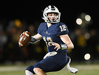 NWA Democrat-Gazette/CHARLIE KAIJO Bentonville West quarterback Dalton Mcdonald (12) looks for a receiver, Friday, November 8, 2019 during a football game at Bentonville West High School in Centerton.