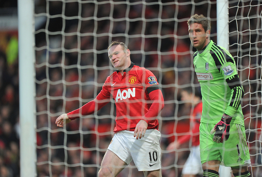 Manchester United's Wayne Rooney and Fulham's Maarten Stekelenburg<br /> <br /> Photo by Dave Howarth/CameraSport<br /> <br /> Football - Barclays Premiership - Manchester United v Fulham - Sunday 9th February 2014 - Old Trafford - Manchester<br /> <br /> &copy; CameraSport - 43 Linden Ave. Countesthorpe. Leicester. England. LE8 5PG - Tel: +44 (0) 116 277 4147 - admin@camerasport.com - www.camerasport.com