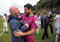 Auckland City goalkeeping coach Simone Naddi congratulates Enaut Zubikarai after winning the Oceania Football Championship final (second leg) football match between Team Wellington and Auckland City FC at David Farrington Park in Wellington, New Zealand on Sunday, 7 May 2017. Photo: Dave Lintott / lintottphoto.co.nz