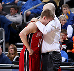 SIOUX FALLS, SD - MARCH 5:  South Dakota head coach, Craig Smith, comforts senior Casey Kasperbauer #14 in the 2016 Summit League Tournament. (Photo by Dave Eggen/Inertia)