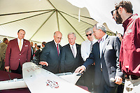 Celebrating Mississippi State's recent designation by the Federal Aviation Administration as a National Center of Excellence for Unmanned Aircraft Systems, MSU President Mark E. Keenum, from left, Vice President for Research and Economic Development David Shaw, Mississippi Development Authority Executive Director Glenn McCullough Jr., Gov. Phil Bryant, Professor and Northern Gulf Institute and Geosystems Research Institute Director Robert Moorhead and GRI Coordinator Lee Hathcock, look at an Unmanned Aerial Vehicle on display after a campus press conference and UAV demonstration Friday [June 5].<br />