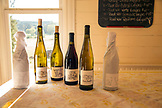 USA, Oregon, Willamette Valley, bottles of wine sit on a table at Big Table Farms, Gaston