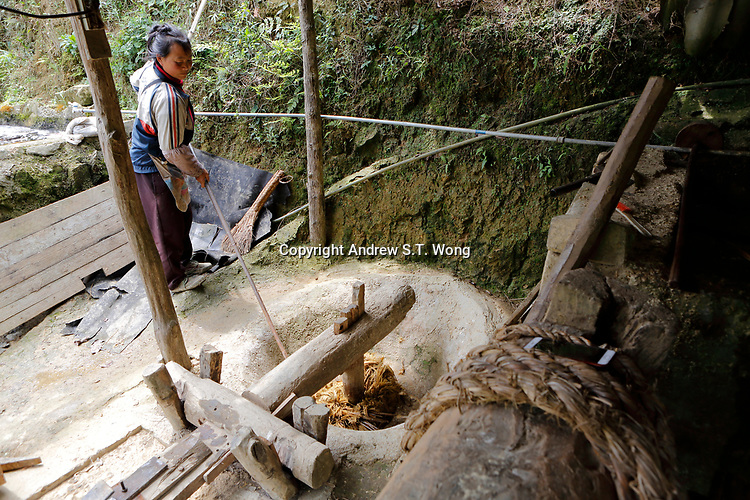 A woman makes traditional paper from bamboo at Wangmo County in China's southwestern Guizhou Province, April 2019.