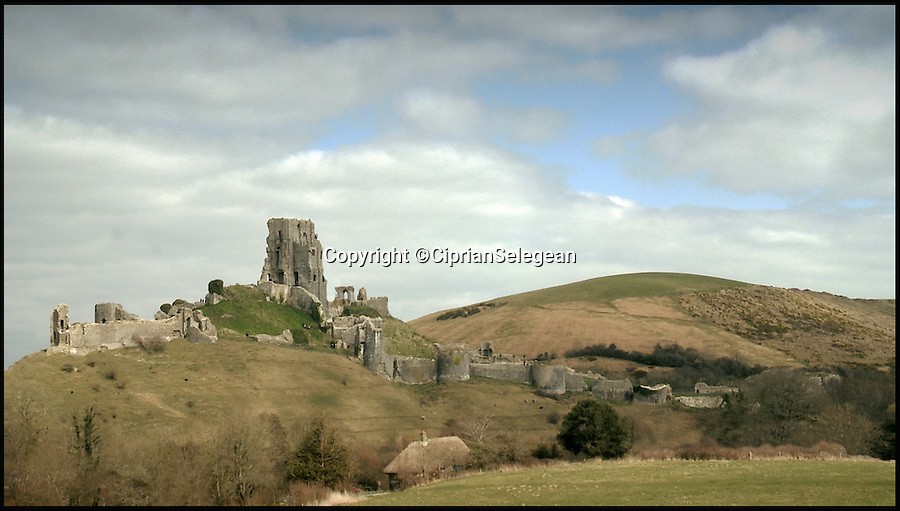 BNPS.co.uk (01202 558833)<br /> Pic: CiprianSelegean/BNPS<br /> <br /> Corfe castle as it is today.<br /> <br /> A computer animation student is taking tourists back to medieval times with his painstaking transformation of the ruins of an ancient castle.<br /> <br /> Ciprian Selegean's footage is so realistic it looks like someone has filmed the towering stone fortress now, but he actually digitally reconstructed what Corfe Castle in Dorset looked like in its prime.<br /> <br /> The 22-year-old University of Portsmouth student spent several months researching the history of the important monument and then brought the castle to life using several software programmes to create a realistic, moving 3D representation.<br /> <br /> The clever historical reconstruction makes it look as if the impressive stronghold was never destroyed in 1646 and even has a guardsman standing watch at the castle gate. <br /> <br /> The digital image then falls away to reveal what people can actually see at the site today.