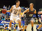 BROOKINGS, SD - JANUARY 18:  Brayden Carlson #12 from South Dakota State University dribbles around the defense of Caleb Steffensmeier #12 from Omaha in the first half of their Summit League game Saturday afternoon at Frost Arena in Brookings. (Photo by Dave Eggen/Inertia)