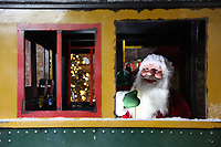 Pictured: A Father Christmas in the showroom train. Thursday 16 November 2017<br /> Re: Festive company which manufactures tinsel in Cwmbran, Wales, UK.