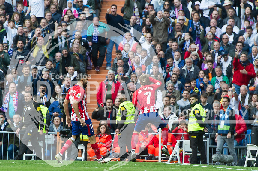 Atletico Madrid's French forward Antoine Griezmann celebrates after scoring<br /> Spanish league football match Real Madrid vs Atletico de Madrid at the Santiago Bernabeu stadium in Madrid on April 8, 2018.