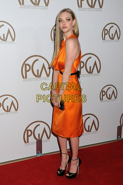 Amanda Seyfried.At the 24th Annual Producers Guild Awards held at the Beverly Hilton Hotel, Beverly Hills, California, USA, .26th January 2013..PGAs PGA arrivals full length orange dress   black belt  draped cowl neck peep toe ankle strap sandals belt shoes  clutch bag sleeveless  side .CAP/ADM/BP.©Byron Purvis/AdMedia/Capital Pictures.