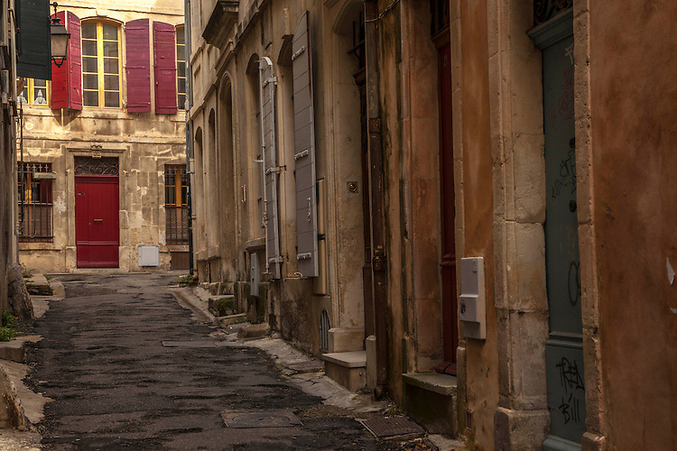 The roman town of Arles, in Provence, is a patchwork of roman ruiins, medieval streets, street-side cafes, and museums.