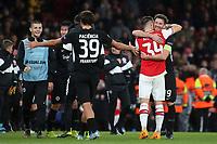 Arsenal's Granit Xhaka hugs Eintracht Frankfurt captain, David Abraham, at the final whistle as Eintracht Frankfurt celebrate their victory during Arsenal vs Eintracht Frankfurt, UEFA Europa League Football at the Emirates Stadium on 28th November 2019