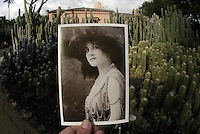 Among the first things Madame Walska planted after purchasing Lotusland was; cacti and succulents. HM story on Lotusland botanical garden in Santa Barbara, Calif.. Ganna Walska, pictured, foreground, turned the Montecito estate she purchased in 1941 into gardens called 'Lotusland'. Two decades after the Polish soprano's death in 1984, her garden remains the horticultural Wonderland she envisioned in the years she was single-mindedly ordering workmen to lever giant boulders into half a dozen new positions and selling her jewels-or so legend has it-to finance one more shipment of rareplants. A performer to the core, Walska, born Hanna Puacz in 1887, always intended her work to be admired, stipulating in her will that Lotusland's grounds be open to visitors. (Tours, for which reservations are required, are offered from mid February to mid-November.) Once inside the estate's pink walls, it doesn't take a visitor long to realize that the diva didn't so much retire from the stage as bring it with her. Set against a backdrop of Montecito's rugged mountains, Walska's 37 acres are divided into more than a dozen gardens, each a seemingly separate world.(*ED NOTE: it is not 'Lotus' season....they have HO photo is needed)..