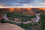 """Framed by sandstone along Tsegi Overlook, a flooded Chinle Wash creates a """"horseshoe bend"""" around the De Chelly sandstone walls"""
