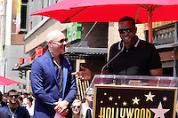 HOLLYWOOD, CA - JULY 15: Pitbull, pictured with Luther Campbell, receives star at the Hollywood Walk of Fame in Hollywood, California on July 15, 2016. Credit: David Edwards/MediaPunch
