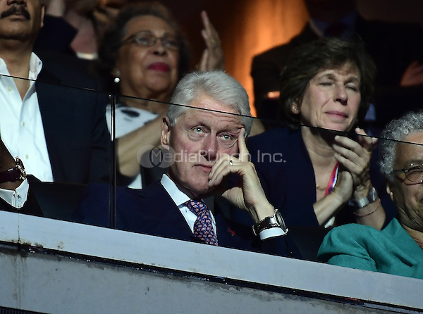 Former United States President Bill Clinton looks on as first lady Michelle Obama makes remarks at the 2016 Democratic National Convention at the Wells Fargo Center in Philadelphia, Pennsylvania on Monday, July 25, 2016.<br /> Credit: Ron Sachs / CNP/MediaPunch<br /> (RESTRICTION: NO New York or New Jersey Newspapers or newspapers within a 75 mile radius of New York City)