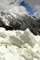 Ice, snow and mountain against blue sky. Hahntennjoch pass, between Imst and Reutte in Austria.