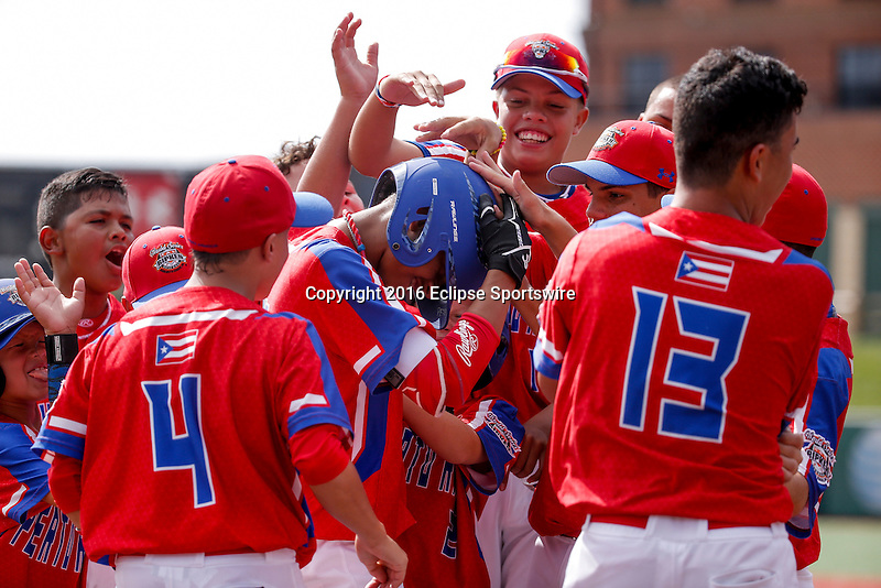 ABERDEEN, MD - AUGUST 02: Team Puerto Rico celebrates scoring a run during a game between the Dominican Republic and Puerto Rico during the Cal Ripken World Series at The Ripken Experience Powered by Under Armour on August 2, 2016 in Aberdeen, Maryland. (Photo by Ripken Baseball/Eclipse Sportswire/Getty Images)