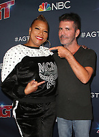 HOLLYWOOD, CA - SEPTEMBER 10: Queen Latifah and Simon Cowell at America's Got Talent Season 14 Live Show Red Carpet at The Dolby Theatre in Hollywood, California on September 10, 2019. Credit: Faye Sadou/MediaPunch