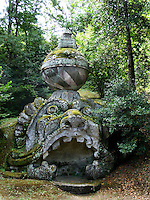 Bomarzo, Viterbo - Parco dei Mostri o Sacro Bosco, complesso monumentale realizzato nel 1547con grandi sculture di figure mitologiche del genere grotesque. Statua di Proteo Glauco<br /> Bomarzo, Viterbo - Monster Park or Sacro Bosco, a monumental complex built in 1547 with large sculptures of mythological figures such grotesque. Statue of Proteo Glauco