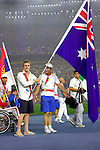 Australia's Matthew Cowdrey carries the flag in the Beijing Paralympic Games Closing Ceremony