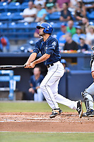 Asheville Tourists first baseman Jacob Bosiokovic (21) hits a home run during a game against the Hickory Crawdads at McCormick Field on July 13, 2017 in Asheville, North Carolina. The Tourists defeated the Crawdads 9-4. (Tony Farlow/Four Seam Images)
