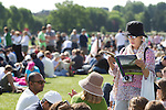 Mcc0038137 . Daily Telegraph..Crowds queue in an adjacent field on the first day of Wimbledon...25 June 2012