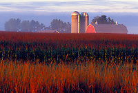 A farm near Abbotsford, Wis. glows in the early morning light of dawn.