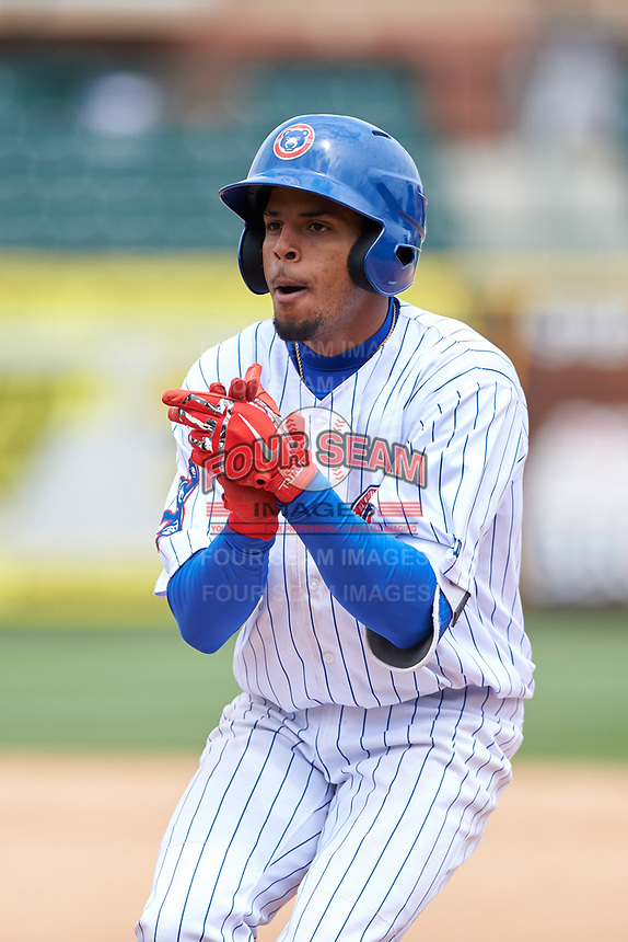 South Bend Cubs Christopher Morel (29) celebrates after reaching first base in the ninth inning during a Midwest League game against the Cedar Rapids Kernels at Four Winds Field on May 8, 2019 in South Bend, Indiana. South Bend defeated Cedar Rapids 2-1. (Zachary Lucy/Four Seam Images)