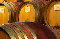 Oak barrels for aging wine in the wine cellar. Domaine Yves Cuilleron, Chavanay, Ampuis, Rhone, France, Europe