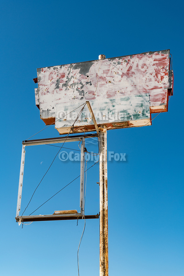 Sign at abandoned store with crescent moon along the I-80 frontage road, Imlay, Nevada