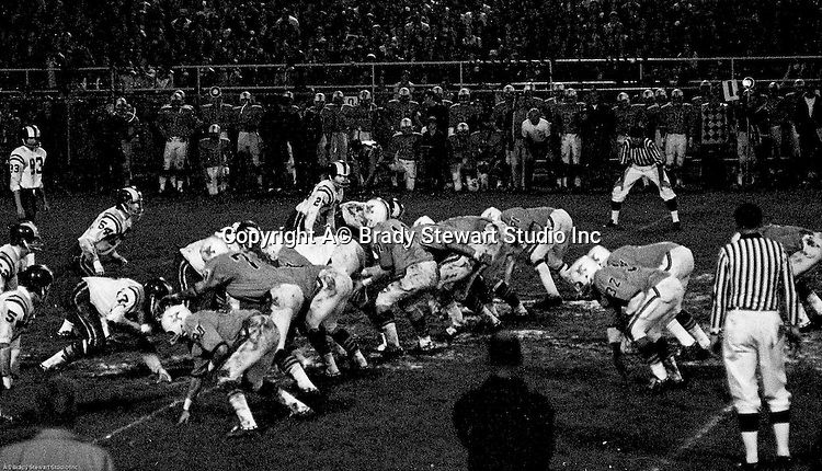 Bethel Park PA:  Offensive play with the Bethel Park offense ready to run a play.  Others in the photo; bruce Evanovich 80, Jim Dingeldine 73, Glenn Eisaman, Don Troup 51, Dennis Franks 66, Joe Barrett 75, Gary Biro 81, Chip Huggins 32, Clark Miller 30, Mike Stewart 11. The Bethel Park defense recovered 5 fumbles but the offense was not able to score against the Mt Lebanon Defense.  The field conditions were herendous, after every play you had to get the saw dust out of your eyes. After a highly disputed non-TD call  by Art Walker's brother in law, the undefeated Mt Lebanon Blue Devils  ended up winning the Western Conference.  The defensive unit was one of the best in Bethel Park history only allowing a little over 7 points a game.