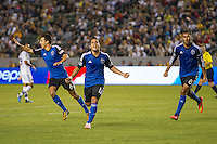 CARSON, CA - August 8, 2014: San Jose Earthquake players Shea Salinas (6), Matias Perez Garcia (11) and Chris Wondowlowski (8) celebrate Garcia's goal during the LA Galaxy vs San Jose Earthquakes match at the StubHub Center in Carson, California. Final score, LA Galaxy 2, San Jose Earthquakes 2.