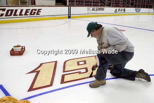 Paul Gallivan touches up the border on the 19 (Brock Bradford). Paul Gallivan and his crew paint the numbers of any senior players and the initials of any senior managers of the men's and women's Boston College hockey teams at center ice prior to the final home game of the regular season.  On the evening of Tuesday, March 3, 2009, they painted the numbers and initials for the men's team after cutting out the women's numbers earlier that day (the women's regular season ends two weeks earlier than the men's.)