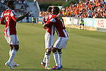 05 June 2012: Chivas USA's Juan Agudelo (11) celebrates his first half goal with Laurent Courtois (FRA) and Rauwshan McKenzie (4). The Carolina RailHawks (NASL) lost 1-2 to Club Deportivo Chivas USA (MLS) at WakeMed Soccer Stadium in Cary, NC in a 2012 Lamar Hunt U.S. Open Cup fourth round game.