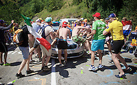 Nordic TV crew experiencing the craziness at the Dutch Corner (nr7) up Alpe d'Huez (1 hour before the passing of the race)<br /> <br /> stage 20: Modane Valfréjus - Alpe d'Huez (111km)<br /> 2015 Tour de France
