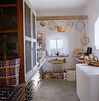 The well orgainsed larder houses a collection of wine and baskets