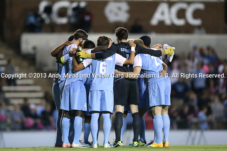 08 October 2013: UNC's starters huddle before the game. The University of North Carolina Tar Heels hosted the Clemson University Tigers at Fetzer Field in Chapel Hill, NC in a 2013 NCAA Division I Men's Soccer match. Clemson won the game 2-1 in overtime.