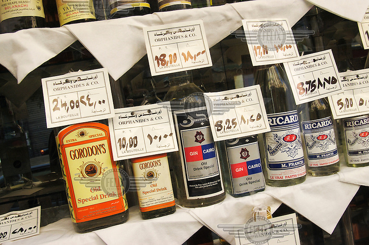 Locally produced alcohol, with familiar-seeming names on display in shop window. Sale is very restricted, and imported brands prohibitively expensive.