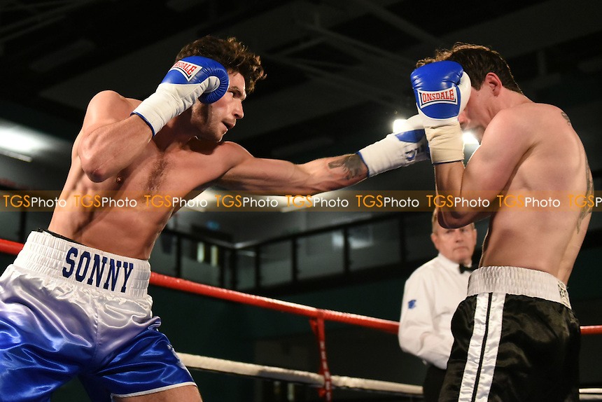 Sonny Whiting (blue/white shorts) defeats Scott Hilman during a Boxing Show at the Westcroft Leisure Centre on 11th February 2017