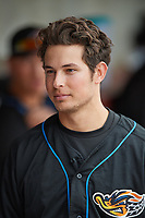 Akron RubberDucks designated hitter Tyler Krieger (15) in the dugout before a game against the Binghamton Rumble Ponies on May 12, 2017 at NYSEG Stadium in Binghamton, New York.  Akron defeated Binghamton 5-1.  (Mike Janes/Four Seam Images)