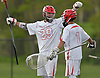 Mike Gomez #29 of Half Hollow Hills East, left, celebrates with goalie Kyle Bockelman #1 after teammate Dillon Studdert #6 (not in picture) scored a goal in the fourth quarter of a Suffolk County varsity boys lacrosse game against West Islip at Half Hollow Hills High School East on Tuesday, May 9, 2017. Hills East rallied from an early 6-2 deficit to win 14-10.