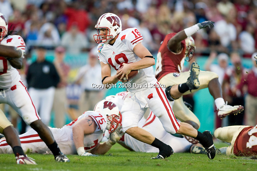 ORLANDO, FL - DECEMBER 27: Quarterback Dustin Sherer #18 of the Wisconsin Badgers scrambles for yardage against the Florida State Seminoles during the Champs Sports Bowl on December 27, 2008 at the Citrus Bowl in Orlando, Florida. Florido State beat Wisconsin 42-13. (Photo by David Stluka)