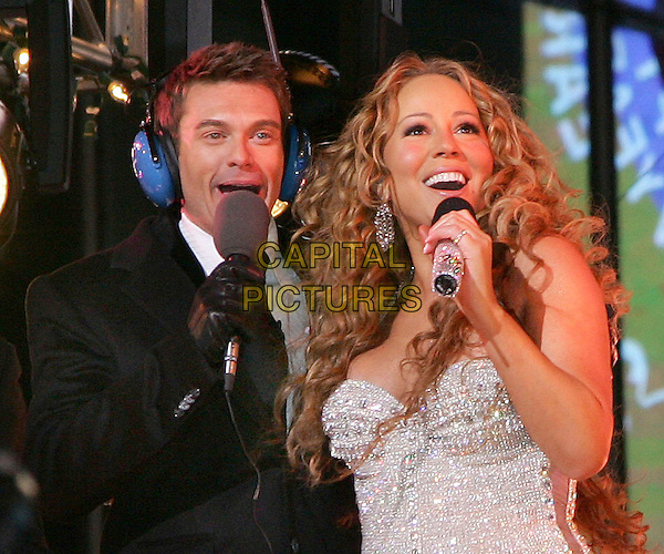 RYAN SEACREST & MARIAH CAREY.New Year's Eve 2006 at Times Square, NYC, New York, NY.January 1st, 2006.Photo: Jackson Lee/Admedia/Capital Pictures.Ref: JL/ADM.half length microphone headphones.www.capitalpictures.com.sales@capitalpictures.com.© Capital Pictures.