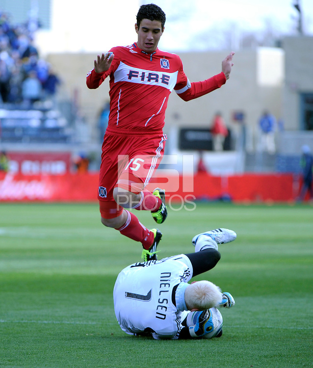 Chicago Fire forward Orr Barouch (15) leaps over Sporting KC goalkeeper Jimmy Nielsen (1) after a Nielsen save.  The Chicago Fire defeated Sporting KC 3-2 at Toyota Park in Bridgeview, IL on March 27, 2011.